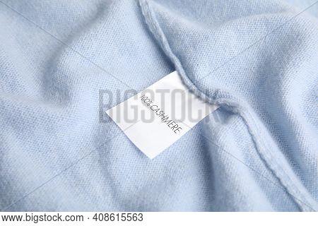Warm Light Blue Cashmere Sweater With Label, Closeup