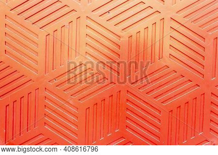 Red Plastic Surface With Repetitive Geometric Shapes. Seamless Geometrical Patterns With Rhombuses,
