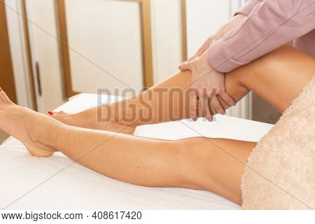 Relaxed Young Woman Having Healing Body Massage. Close-up Of The Hands Of Female Massage Therapist M