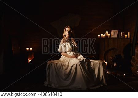 Pregnant Woman In Long White Dress Touching Her Belly In Decoration Studio With Stars, Moon. Motherh