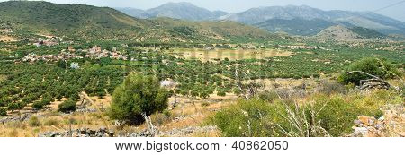 Panoramic View On Mountain Village In Sunny Day