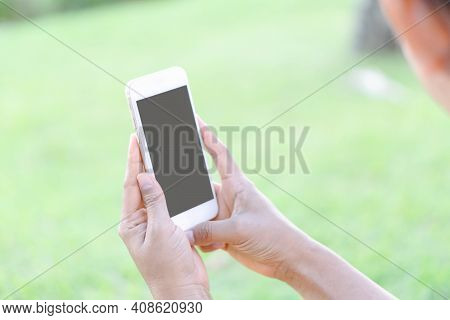 Closeup Woman Hand Playing Smartphone Mobile With Relaxing Feelling, Selective Focus