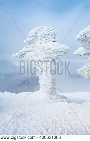 Cross in sparkling snow on Mount Petros top, Ukraine