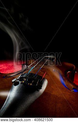 Smoky dramatic violin close up shallow depth of field