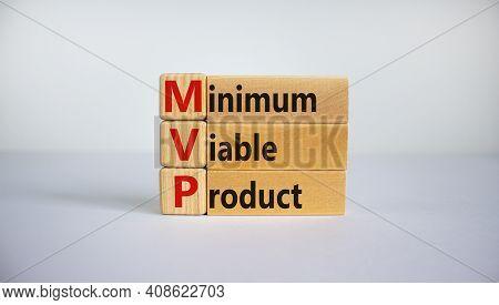 Mvp, Minimum Viable Product Symbol. Wooden Cubes And Blocks With Words Mvp, Minimum Viable Product.