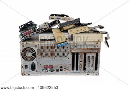 Pile Of Electronic Waste, Rusty Old Computer Cases And Obsolete Computer Hardware Such As Motherboar