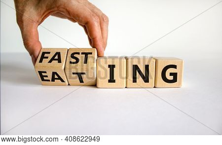 Fasting Or Eating Symbol. Doctor Turns Wooden Cubes And Changes The Word 'eating' To 'fasting'. Beau