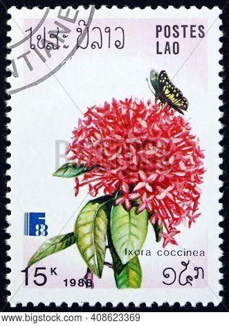 Laos - Circa 1988: A Stamp Printed In Laos Shows Jungle Geranium, Ixora Coccinea, Flowering Plant, C