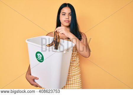 Young asian girl recycling food composting organic fertilizer relaxed with serious expression on face. simple and natural looking at the camera.