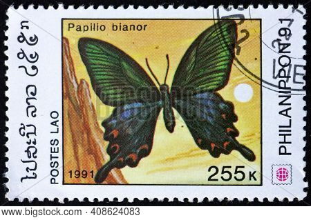 Laos - Circa 1991: A Stamp Printed In Laos Shows Common Peacock, Papilio Bianor, Butterfly, Circa 19