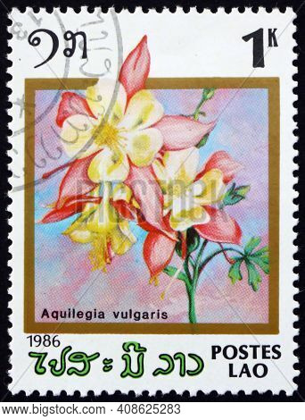 Laos - Circa 1986: A Stamp Printed In Laos Shows European Columbine, Aquilegia Vulgaris, Is A Specie