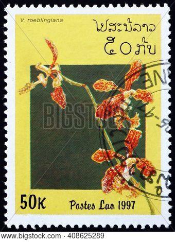 Laos - Circa 1997: A Stamp Printed In Laos Shows Roebelens Vanda, Vanda Roeblingiana, Is A Species O