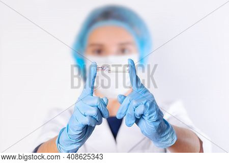 The Doctor Holds An Ampule With A Vaccine In His Hands. Vaccination Of The Population. Vaccination I