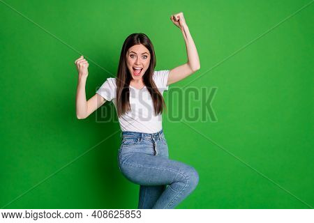 Photo Of Cheerful Winner Woman Dressed Casual Outfit Arms Up Open Mouth Isolated Green Color Backgro