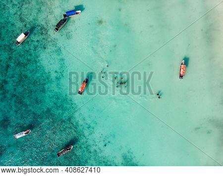 Nungwi, Zanzibar - January 2020: Aerial Drone Shot Of Wooden Traditional Dhow Boats And Black Local