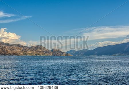 Scenery View Of Rocky Slope Over The Lake In British Columbia