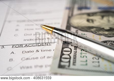 Insurance  Claim Accident Car Form With Us Dollar Banknote, Car Loan, Insurance And Leasing Time Con
