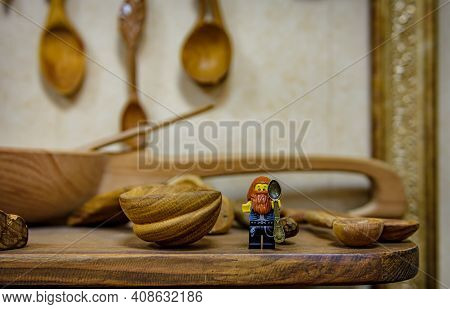 Vladimir, Russia - March 29, 2019: Funny Bearded Hipster Lego-man Minifigure With Small Souvenir Spo