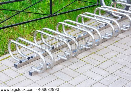 Empty Metal Bike Rack In Parking Lot Of Campus