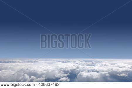 Beautiful Sky Landscape With View From The Plane Above Dense White Clouds High In The Stratosphere O