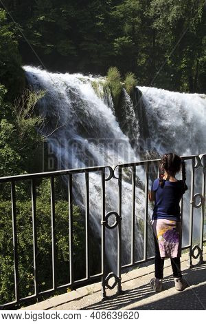 Terni (tr), Italy - May 10, 2016: A Child Looks The Famous Marmore Waterfall, Terni, Umbria, Italy