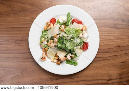 Caesar Salad With Prawns, Lettuce, Quail Eggs, Cherry Tomatoes, Croutons And Parmesan Cheese In A Wh