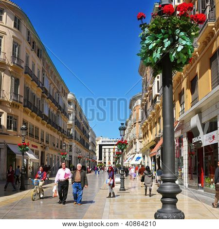 MALAGA, SPAIN - MARCH 12: Calle Larios on March 12, 2012 in Malaga, Spain. This 300 meters long street is the main commercial street of the city and the fifth most expensive shopping street in Spain