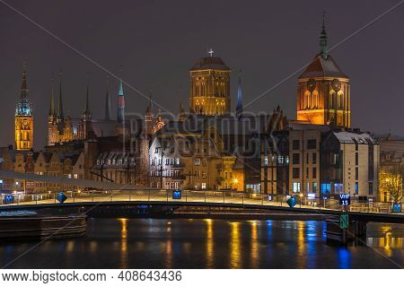 Gdansk, Poland - 02 February 2021: A View Of The Footbridge Over The Motlawa River Connecting The Ma