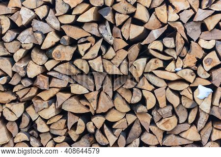 Stacked Stack Of Firewood. Large Woodpile With Chopped Wood. Stacked Stack Of Firewood From The End.
