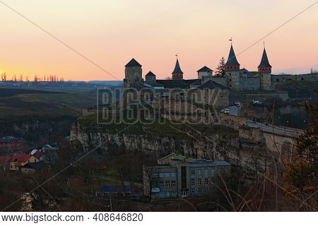 Awesome Aerial Landscape View Of The Old Kamianets-podilskyi Fortress. Panoramic Sunset Sky In The B