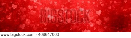 An illustration of a wide modern red hearts background banner