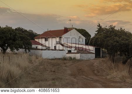 Farm In The Middle Of The Countryside Of The Sierra Of Cordoba Andalusia At Sunset