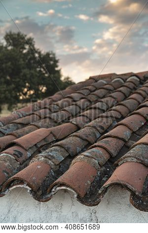Roof Of A Farm In The Middle Of The Countryside Of The Sierra Of Cordoba Andalusia At Sunset