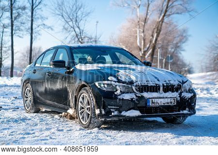 Riga, Latvia. January 10, 2021. Bmw G20 320 Model Covered In Snow Parked Alone In The Parking Lot.
