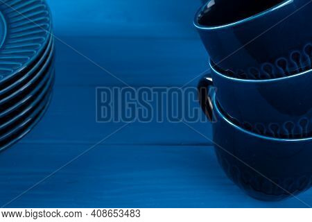 Dark Blue Crockery On Blue Wooden Background