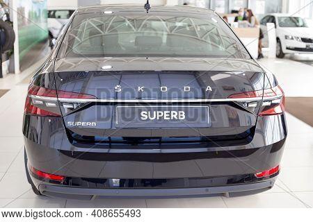 Russia, Izhevsk - September 25, 2020: New Car Business Class Superb In The Skoda Showroom. Back View