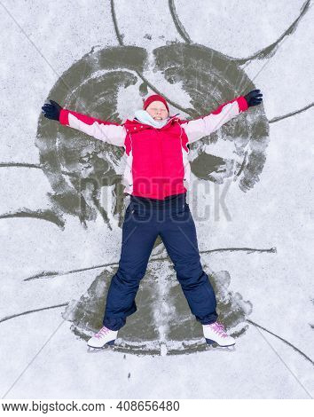Young skater having fun on ice. Skate rink from above.  Winter sport theme.