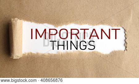Important Things. Text On White Paper Over Torn Paper Background.