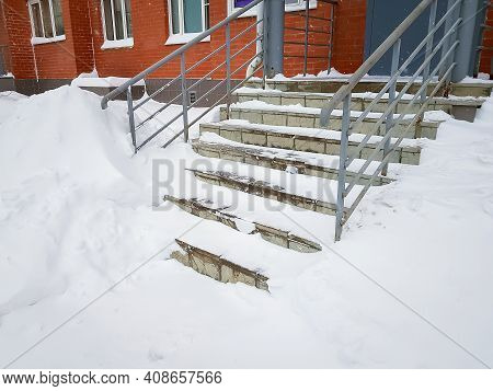Soft Focus Of Snow-covered Staircase. Snow Storm In City. Work For City Services. Weather Forecast.