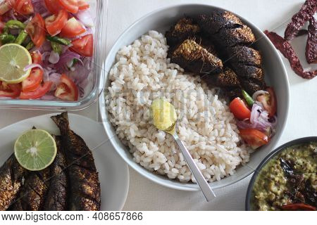Kerala Meals With Red Rice, Sardines Curry, Sardine Fry And Coconut Based Green Gram Curry
