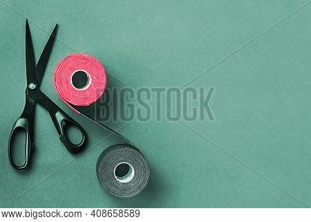 Special Physiotherapy Tapes And Scissors On A Colored Background. Kinesiology Tape Treatment, Elasti