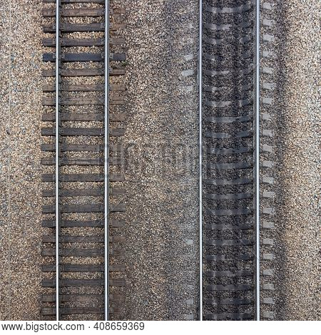 Two Parallel Railroad Tracks From Old Wooden Sleepers And New Concrete Sleepers On Rubble Base. Indu