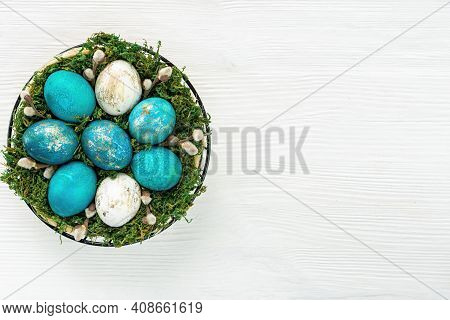Easter Basket With Moss And Willow Twigs With Catkins On A White Wooden Background With Copy Space F