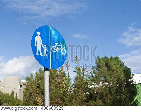 Blue Regulatory Sign For Pedestrians And Cyclists In The Park