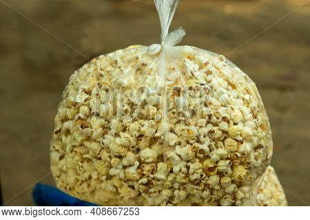 Popcorn Into Polythene Bag That Is From Maize Or Popped Corn, Popcorns Or Pop-corn Is A Variety Of C