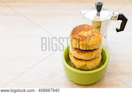 Homemade Cottage Cheese Pancakes Syrniki Stack On Round Green Bowl With Geyser Coffee Maker On White