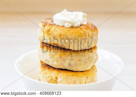 Homemade Cottage Cheese Pancakes Syrniki Stack On Round Glossy White Bowl On White Rustic Natural Wo