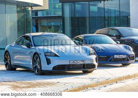 New Porsche Taycan Turbo S Sports Car White Gray Color. Russia, Saint-petersburg, 09 February 2021.