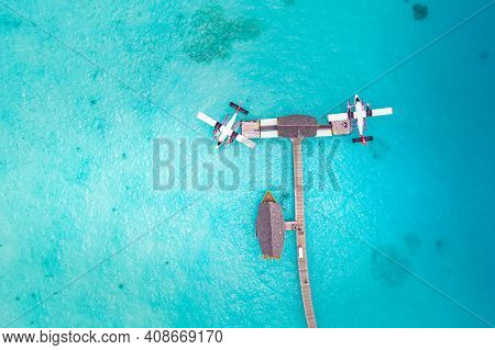 Beautiful Aerial View Of Maldives Jetty Seaplane Top View With Wooden Boat Dhoni And Tropical Beach,