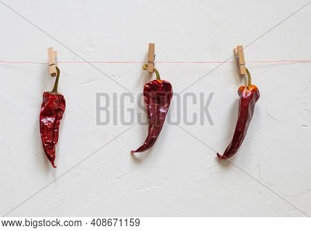 Close-up. Of Red Chili Peppers Over White Background. Three Peppers. Chili For Sowing. High Quality